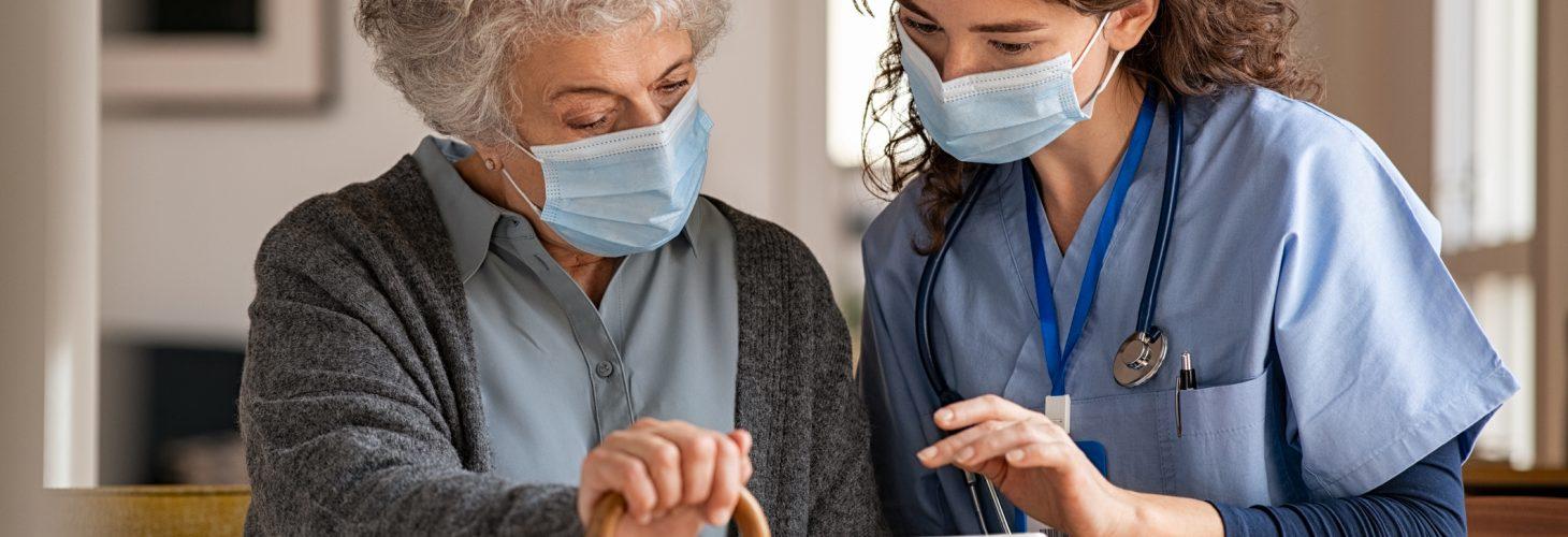 Senior woman and nurse using digital tablet